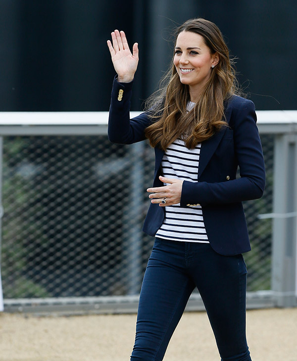 <div class='meta'><div class='origin-logo' data-origin='AP'></div><span class='caption-text' data-credit='AP'>Britain's Kate, The Duchess of Cambridge waves as she leaves Queen Elizabeth Olympic Park in London, Friday, Oct. 18, 2013.</span></div>