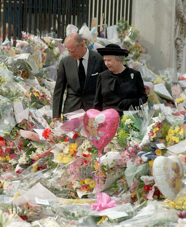 "<div class=""meta image-caption""><div class=""origin-logo origin-image none""><span>none</span></div><span class=""caption-text"">Queen Elizabeth II and her husband the Duke of Edinburgh view the floral tributes to Diana, Princess of Wales, at London's Buckingham Palace, Friday Sept. 5 1997. (AP)</span></div>"