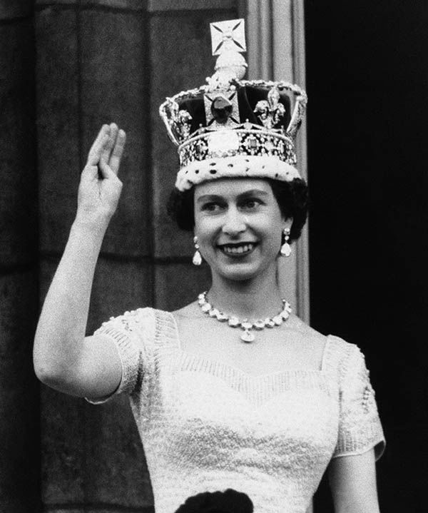 "<div class=""meta image-caption""><div class=""origin-logo origin-image none""><span>none</span></div><span class=""caption-text"">Queen Elizabeth II, wearing the Imperial Crown, smiles and waves to the crowd from the balcony of Buckingham Palace on June 3, 1953 following her coronation. (AP)</span></div>"