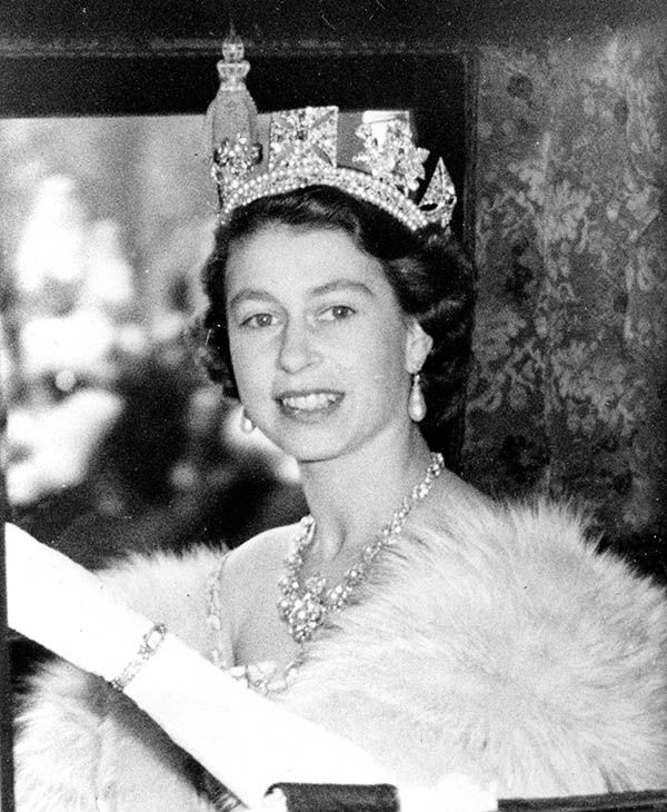 "<div class=""meta image-caption""><div class=""origin-logo origin-image none""><span>none</span></div><span class=""caption-text"">Queen Elizabeth II is shown in the state coach as she leaves Buckingham Palace for the Houses of Parliament in London on Nov. 4, 1952. (AP)</span></div>"