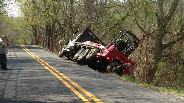 Truck tips off roadway in Hockessin, Del.