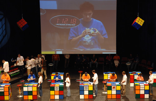 "<div class=""meta image-caption""><div class=""origin-logo origin-image ""><span></span></div><span class=""caption-text"">Players compete in solving the Rubik's cubes during the final of the 2007 Rubik's Cube World Championships in Budapest, Hungary, Sunday, Oct. 7, 2007. (AP Photo/Bela Szandelszky)</span></div>"