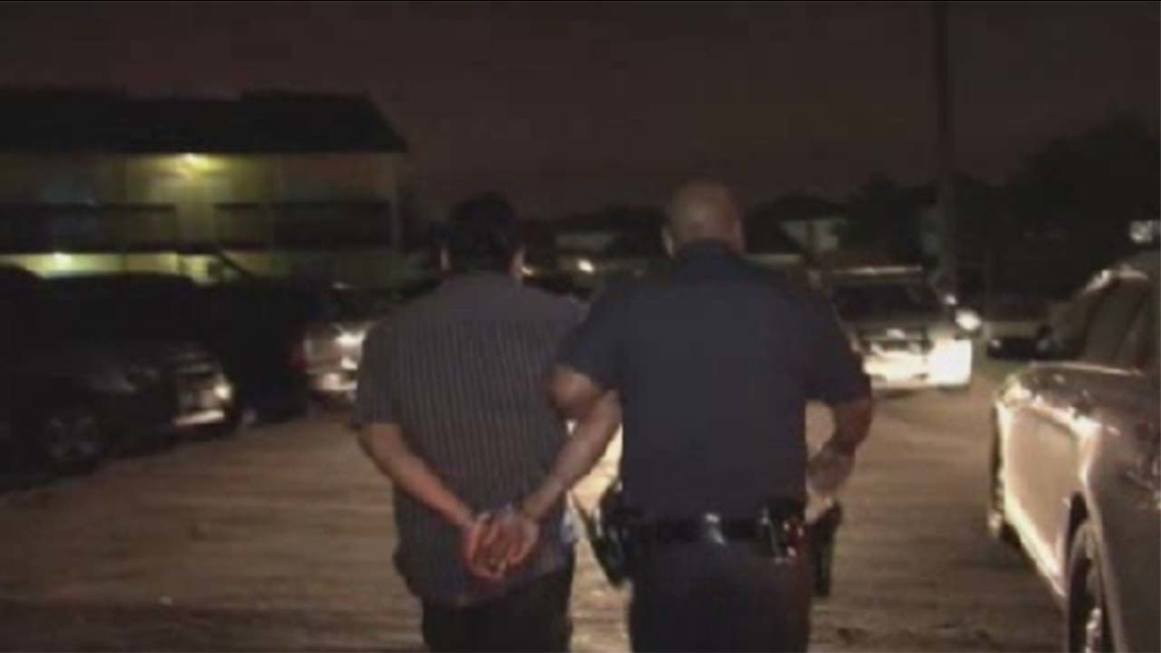 Suspect taken out in handcuffs by a Harris County Sheriff's deputy