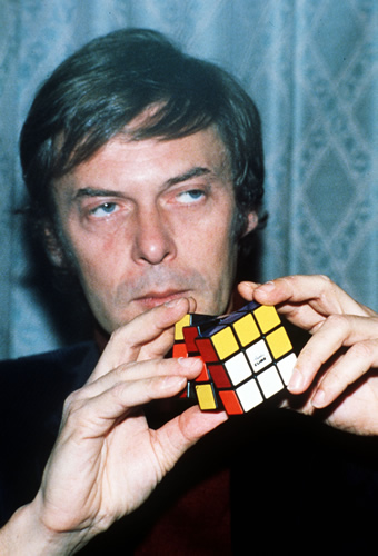 "<div class=""meta image-caption""><div class=""origin-logo origin-image ""><span></span></div><span class=""caption-text"">Erno Rubik, a Professor at the Colleges of Applied Science at Budapest University, pictured in London, Dec. 10, 1981 with his ""Rubik Cube"". (AP-Photo/John Glanvill)</span></div>"