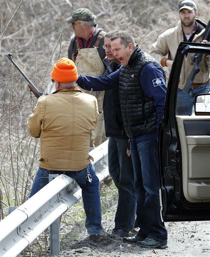 """<div class=""""meta image-caption""""><div class=""""origin-logo origin-image none""""><span>none</span></div><span class=""""caption-text"""">Albany County Sheriff Craig Apple yells at a man who was shooting at a herd of buffalo on Friday, April 24, 2015, in Coeymans, N.Y. (AP Photo/ Mike Groll)</span></div>"""