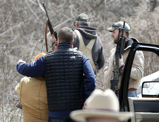 """<div class=""""meta image-caption""""><div class=""""origin-logo origin-image none""""><span>none</span></div><span class=""""caption-text"""">A man who was shooting at a herd of buffalo is detained by law enforcement on Friday, April 24, 2015, in Coeymans, N.Y. (AP Photo/ Mike Groll)</span></div>"""