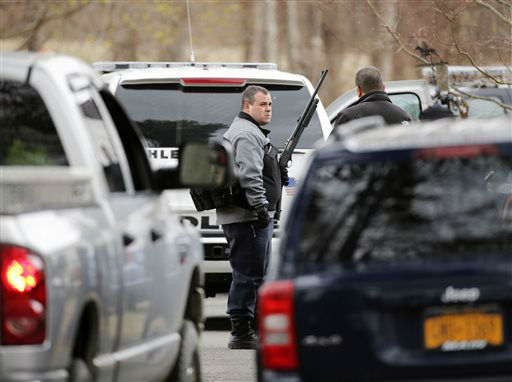 """<div class=""""meta image-caption""""><div class=""""origin-logo origin-image none""""><span>none</span></div><span class=""""caption-text"""">Law enforcement officials stand in a driveway near where a herd of buffalo is on the loose on Friday, April 24, 2015, in Bethlehem, N.Y. (AP Photo/ Mike Groll)</span></div>"""