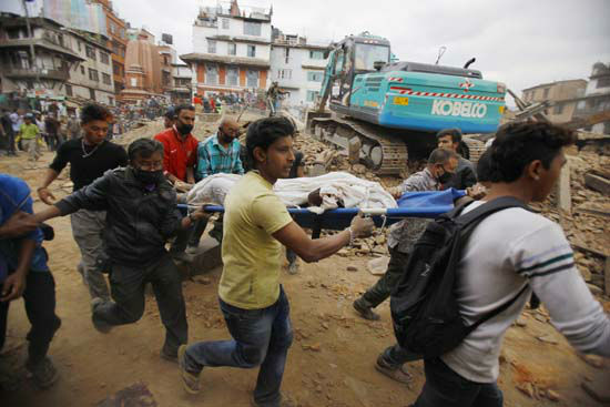 """<div class=""""meta image-caption""""><div class=""""origin-logo origin-image none""""><span>none</span></div><span class=""""caption-text"""">Volunteers carry the body of a victim on a stretcher, recovered from the debris of a building that collapsed (AP Photo/Niranjan Shrestha)</span></div>"""