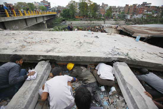 """<div class=""""meta image-caption""""><div class=""""origin-logo origin-image none""""><span>none</span></div><span class=""""caption-text"""">Rescuers look for victims under a building that collapsed after an earthquake in Kathmandu, Nepal (AP Photo/ Niranjan Shrestha)</span></div>"""