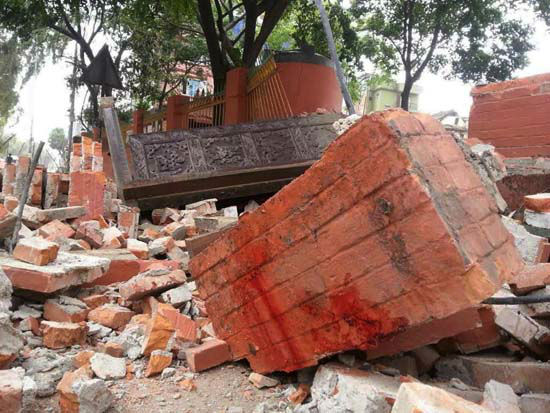 "<div class=""meta image-caption""><div class=""origin-logo origin-image none""><span>none</span></div><span class=""caption-text"">In this photo released by China's Xinhua News Agency, a collapsed building is seen in Nepal's capital Kathmandu (AP Photo/ Zhou Shengping)</span></div>"