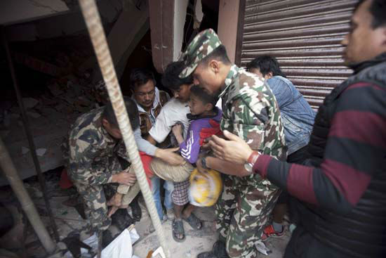 "<div class=""meta image-caption""><div class=""origin-logo origin-image none""><span>none</span></div><span class=""caption-text"">Volunteers carry an injured boy after rescuing him from the debris of a building that was damaged in an earthquake in Kathmandu, Nepal (AP Photo/ Niranjan Shrestha)</span></div>"