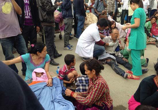 "<div class=""meta image-caption""><div class=""origin-logo origin-image none""><span>none</span></div><span class=""caption-text"">An injured man receives treatment outside the Medicare Hospital in Kathmandu, Nepal (AP Photo/ Niranjan Shrestha)</span></div>"