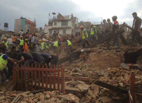 "<div class=""meta image-caption""><div class=""origin-logo origin-image none""><span>none</span></div><span class=""caption-text"">Rescuers clear the debris at Durbar Sqaure after an earthquake in Kathmandu, Nepal, Saturday, April 25, 2015 (AP Photo/ Niranjan Shrestha)</span></div>"