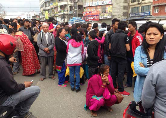 "<div class=""meta image-caption""><div class=""origin-logo origin-image none""><span>none</span></div><span class=""caption-text"">A group of people gather outdoors on a street as an earthquake hits Kathmandu city, Nepal (AP Photo/ Niranjan Shrestha)</span></div>"