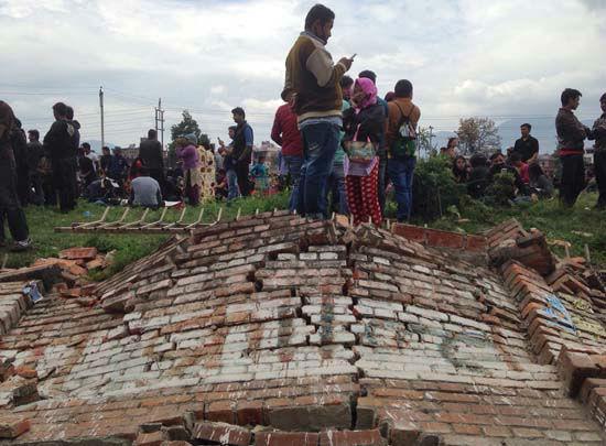 "<div class=""meta image-caption""><div class=""origin-logo origin-image none""><span>none</span></div><span class=""caption-text"">A group of people gather outdoors as an earthquake hits Kathmandu city, Nepal, Saturday, April 25, 2015 (AP Photo/ Niranjan Shrestha)</span></div>"