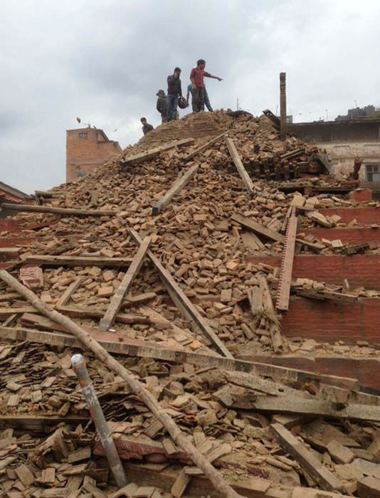 "<div class=""meta image-caption""><div class=""origin-logo origin-image none""><span>none</span></div><span class=""caption-text"">Volunteers help with rescue work at the site of a building that collapsed after an earthquake in Kathmandu, Nepal (AP Photo/ Niranjan Shrestha)</span></div>"