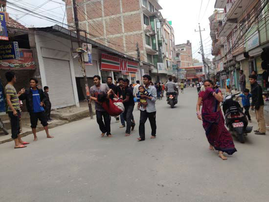 "<div class=""meta image-caption""><div class=""origin-logo origin-image none""><span>none</span></div><span class=""caption-text"">In this photo provided by Guna Raj Luitel, an injured woman is carried just after an earthquake in Kathmandu, Nepal (AP Photo/ Guna Raj Luitel)</span></div>"