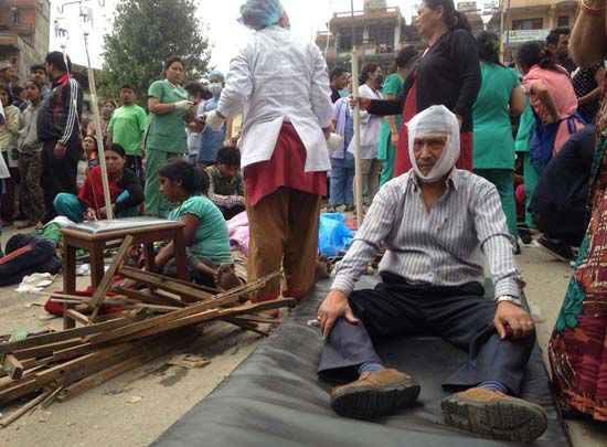 "<div class=""meta image-caption""><div class=""origin-logo origin-image none""><span>none</span></div><span class=""caption-text"">Injured people receive treatment outside the Medicare Hospital in Kathmandu, Nepal (AP Photo/ Niranjan Shrestha)</span></div>"