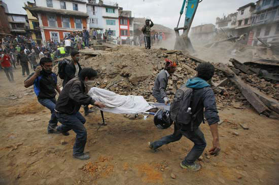 "<div class=""meta image-caption""><div class=""origin-logo origin-image none""><span>none</span></div><span class=""caption-text"">Volunteers carry the body of a victim on a stretcher, recovered from the debris of a building that collapsed (AP Photo/ Niranjan Shrestha)</span></div>"