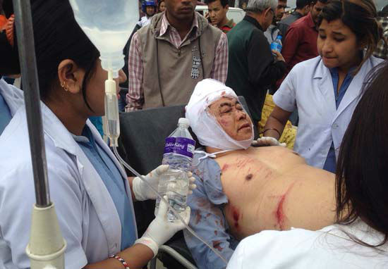 "<div class=""meta image-caption""><div class=""origin-logo origin-image none""><span>none</span></div><span class=""caption-text"">An injured person receives treatment outside the Medicare Hospital in Kathmandu, Nepal (AP Photo/ Niranjan Shrestha)</span></div>"