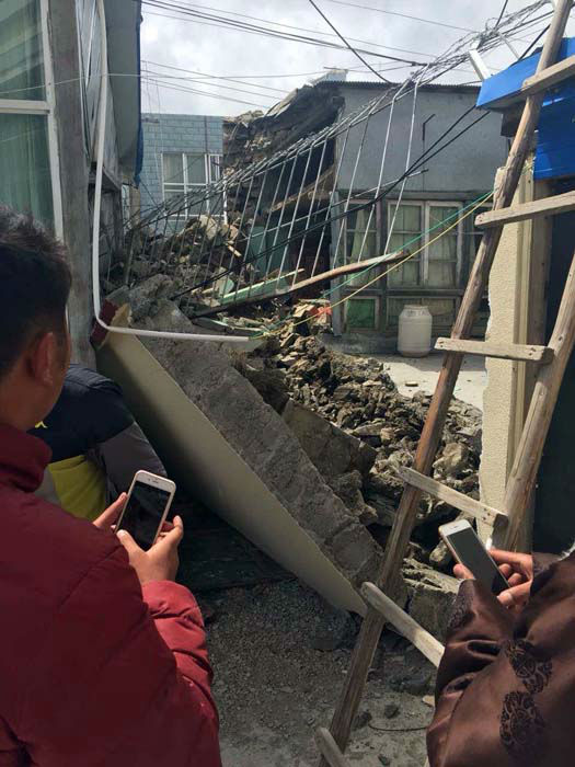 "<div class=""meta image-caption""><div class=""origin-logo origin-image none""><span>none</span></div><span class=""caption-text"">People stand near collapsed houses in Nyalam County of Xigaze Prefecture, southwest China's Tibet Autonomous Region (AP Photo/ Zhang Mao)</span></div>"