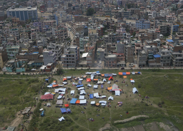 "<div class=""meta image-caption""><div class=""origin-logo origin-image none""><span>none</span></div><span class=""caption-text"">Tents are seen from an airplane window in an open field next to Tribhuwan International Airport Sunday, April 26, 2015, a day after a massive earthquake in Kathmandu, Nepal. (AP Photo/ Wally Santana)</span></div>"