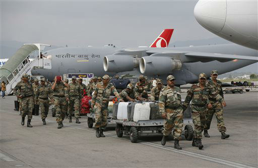 "<div class=""meta image-caption""><div class=""origin-logo origin-image none""><span>none</span></div><span class=""caption-text"">Indian soldiers arrive with supplies at the Tribhuwan International Airport a day after a massive earthquake in Kathmandu, Nepal. (AP Photo/ Wally Santana)</span></div>"