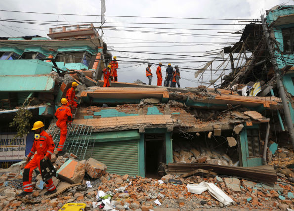"<div class=""meta image-caption""><div class=""origin-logo origin-image none""><span>none</span></div><span class=""caption-text"">India's National Disaster Response Force personnel look for survivors in a building, in Kathmandu, Nepal.(AP Photo/Manish Swarup) (AP Photo/ Manish Swarup)</span></div>"