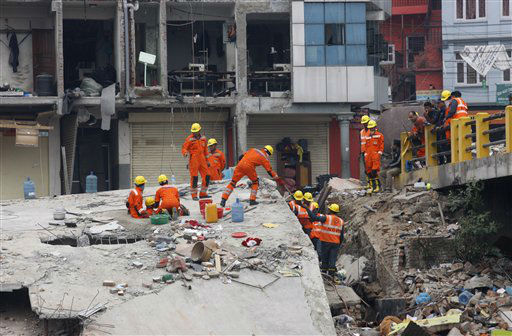 "<div class=""meta image-caption""><div class=""origin-logo origin-image none""><span>none</span></div><span class=""caption-text"">India's National Disaster Response Force (NDRF) personnel look for survivors in the debris of Saturday's earthquake, in Kathmandu, Nepal. (AP Photo/ Bikram Rai)</span></div>"