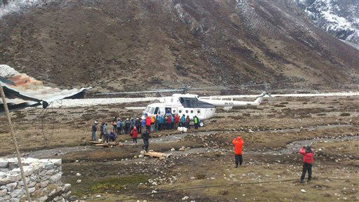 "<div class=""meta image-caption""><div class=""origin-logo origin-image none""><span>none</span></div><span class=""caption-text"">Mountaineers and Nepalese Sherpa guides evacuated from Everest Base Camp wait to board a rescue chopper to be flown to Lukla, in Pheriche, Nepal. (AP Photo/Pasang Dawa Sherpa) (AP Photo/ Pasang Dawa Sherpa)</span></div>"
