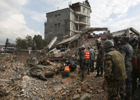 "<div class=""meta image-caption""><div class=""origin-logo origin-image none""><span>none</span></div><span class=""caption-text"">Nepalese policemen look for survivors in the debris of a building that collapsed in an earthquake in Kathmandu, Nepal.  (AP Photo/Manish Swarup) (AP Photo/ Manish Swarup)</span></div>"
