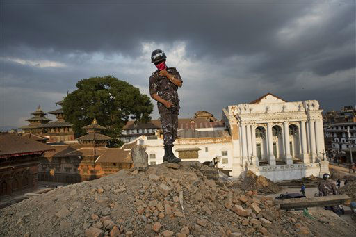 "<div class=""meta image-caption""><div class=""origin-logo origin-image none""><span>none</span></div><span class=""caption-text"">A Nepalese policeman stands atop of a rubble at Basantapur Durbar Square that was damaged in Saturday's earthquake in Kathmandu, Nepal. (AP Photo/Bernat Armangue) (AP Photo/ Bernat Armangue)</span></div>"