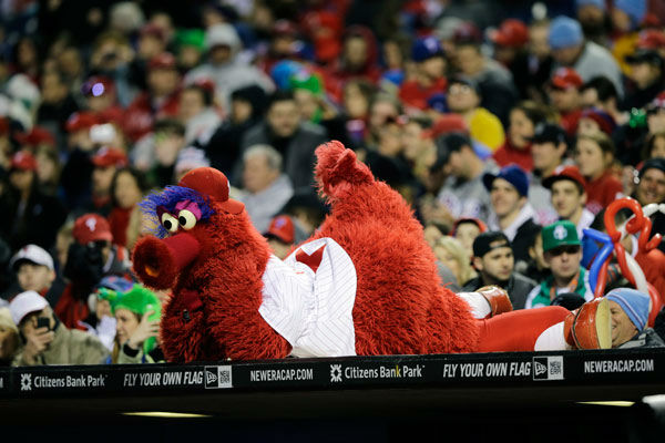 "<div class=""meta image-caption""><div class=""origin-logo origin-image none""><span>none</span></div><span class=""caption-text"">The Philadelphia Phillies mascot, the Phillie Phanatic watches during an exhibition baseball game against the Toronto Blue Jays, Friday, March 29, 2013, in Philadelphia. (AP Photo/ Matt Slocum)</span></div>"