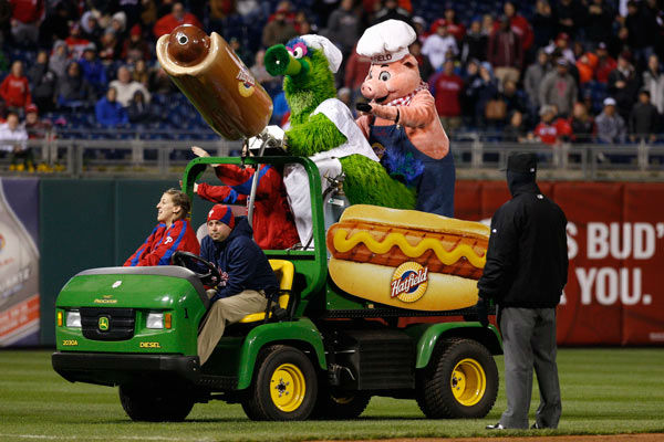 "<div class=""meta image-caption""><div class=""origin-logo origin-image none""><span>none</span></div><span class=""caption-text"">The Phillie Phanatic shoots hot dogs into the stands during the fifth inning of a baseball game against the Boston Red Sox, Thursday, April 9, 2015, in Philadelphia. (AP Photo/ Chris Szagola)</span></div>"