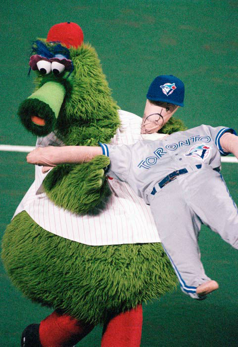 <div class='meta'><div class='origin-logo' data-origin='none'></div><span class='caption-text' data-credit='AP Photo/ Carol Francavilla'>The Phillie Phanatic holds a doll dressed in a Toronto Blue Jays uniform during Game 4 of the 1993 Word Series.</span></div>
