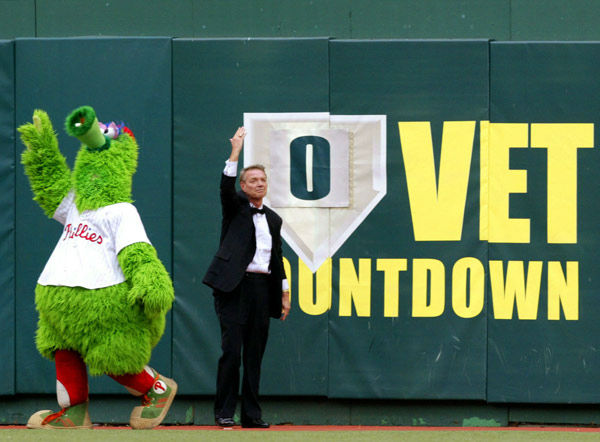 <div class='meta'><div class='origin-logo' data-origin='none'></div><span class='caption-text' data-credit='AP Photo/ RUSTY KENNEDY'>Hall of Famer Harry Kalas and the Phillie Phanatic wave to the crowd after removing the last of the &#34;Vet Countdown&#34; signs on Sunday, Sept. 28, 2003.</span></div>