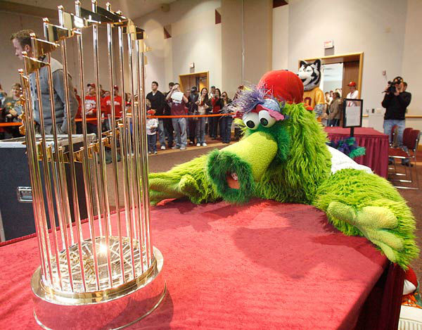 <div class='meta'><div class='origin-logo' data-origin='none'></div><span class='caption-text' data-credit='AP Photo/ Jimmy May'>The Phillie Phanatic eyes up the location of the 2008 World Series Trophy Friday afternoon, Jan. 23, 2009,  at Bloomsburg University, Bloomsburg, Pa.</span></div>