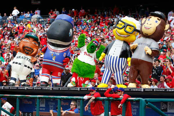 <div class='meta'><div class='origin-logo' data-origin='none'></div><span class='caption-text' data-credit='AP Photo/ Chris Szagola'>The Phillie Phanatic, center, dances with Zooperstars (left to right), Ichiroach Suzuki, Whale Gretzky, Harry Canary and Monkey Mantle on May 18, 2014, in Philadelphia.</span></div>