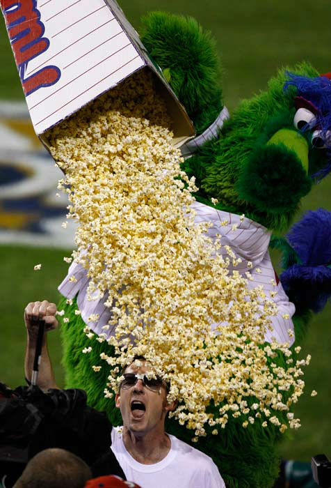 "<div class=""meta image-caption""><div class=""origin-logo origin-image none""><span>none</span></div><span class=""caption-text"">The Phillie Phanatic dumps popcorn on a fan during Game 1 of the NLDS between the  Phillies and the Reds, Wednesday, Oct. 6, 2010. (AP Photo/ Matt Rourke)</span></div>"