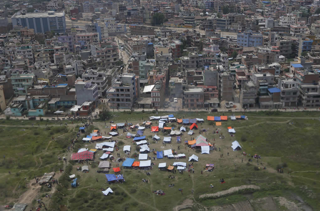 "<div class=""meta image-caption""><div class=""origin-logo origin-image none""><span>none</span></div><span class=""caption-text"">Tents are seen from an airplane window in an open field next to Tribhuwan International Airport on April 26, 2015, a day after a massive quake in Kathmandu, Nepal. (AP Photo/Wally Santana)</span></div>"
