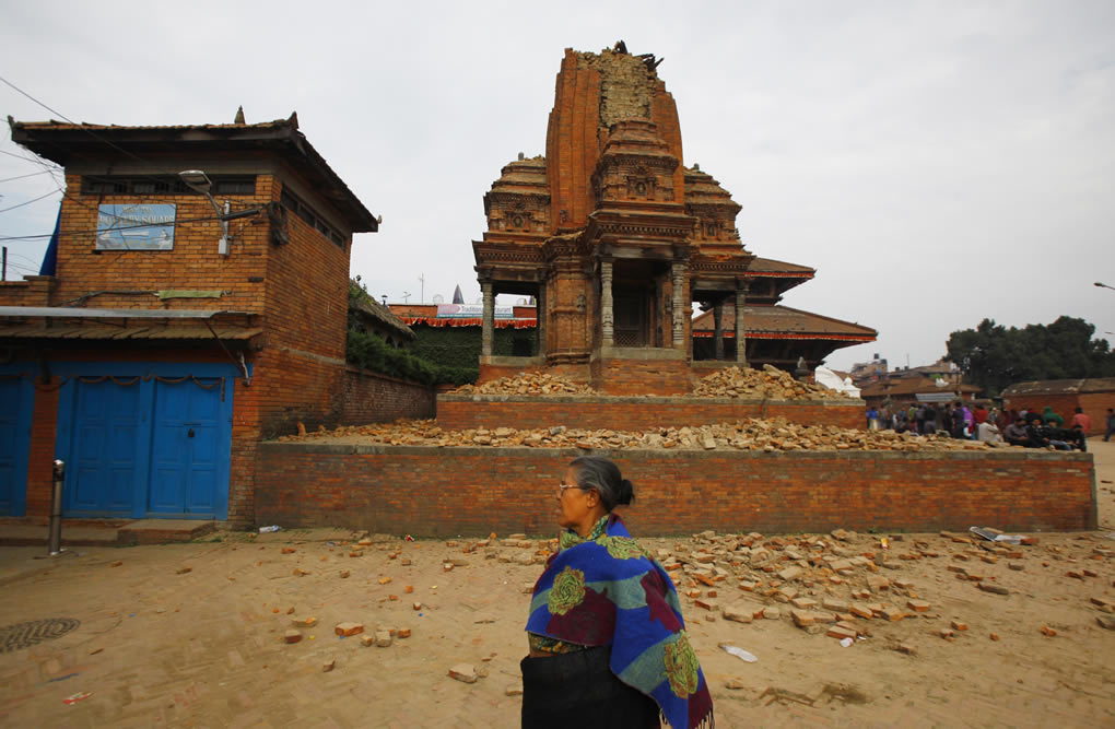 "<div class=""meta image-caption""><div class=""origin-logo origin-image none""><span>none</span></div><span class=""caption-text"">A Nepalese woman walks past a collapsed temple in Bhaktapur Durbar Square after an earthquake in Kathmandu, Nepal, Sunday, April 26, 2015. (AP Photo/Niranjan Shrestha)</span></div>"