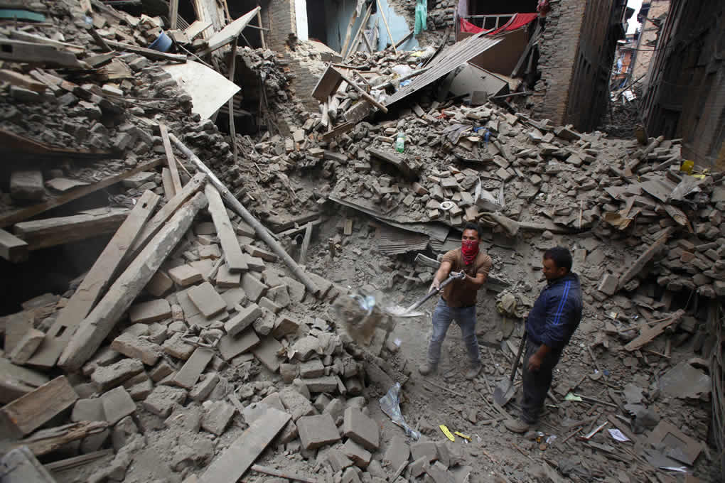 "<div class=""meta image-caption""><div class=""origin-logo origin-image none""><span>none</span></div><span class=""caption-text"">Rescue workers remove debris as they search for victims of earthquake in Bhaktapur near Kathmandu, Nepal, Sunday, April 26, 2015. (AP Photo/Niranjan Shrestha))</span></div>"