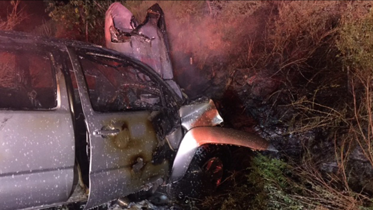 A car burst into flames after crashing and rolling over in Ventura on Sunday, April 26, 2015.