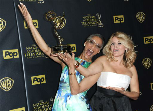 "<div class=""meta image-caption""><div class=""origin-logo origin-image none""><span>none</span></div><span class=""caption-text"">Carla Hall, left, and Daphne Oz pose in the pressroom with the award for outstanding informative talk show host for ""The Chew"" (Photo by Richard Shotwell/Invision/AP) (AP Photo/ Richard Shotwell)</span></div>"