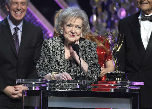"<div class=""meta image-caption""><div class=""origin-logo origin-image none""><span>none</span></div><span class=""caption-text"">Betty White accepts the lifetime achievement award at the 42nd annual Daytime Emmy Awards on Sunday, April 26, 2015 (Photo by Chris Pizzello/Invision/AP) (AP Photo/ Chris Pizzello)</span></div>"