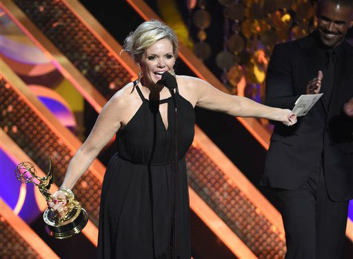 "<div class=""meta image-caption""><div class=""origin-logo origin-image none""><span>none</span></div><span class=""caption-text"">Maura West accepts the award for outstanding lead actress in a drama series at the 42nd annual Daytime Emmy Awards (Photo by Chris Pizzello/Invision/AP) (AP Photo/ Chris Pizzello)</span></div>"