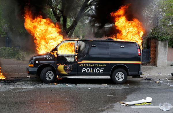 "<div class=""meta image-caption""><div class=""origin-logo origin-image ap""><span>AP</span></div><span class=""caption-text"">A police vehicle burns, Monday, April 27, 2015, during unrest following the funeral of Freddie Gray in Baltimore. (AP Photo/Patrick Semansky)</span></div>"