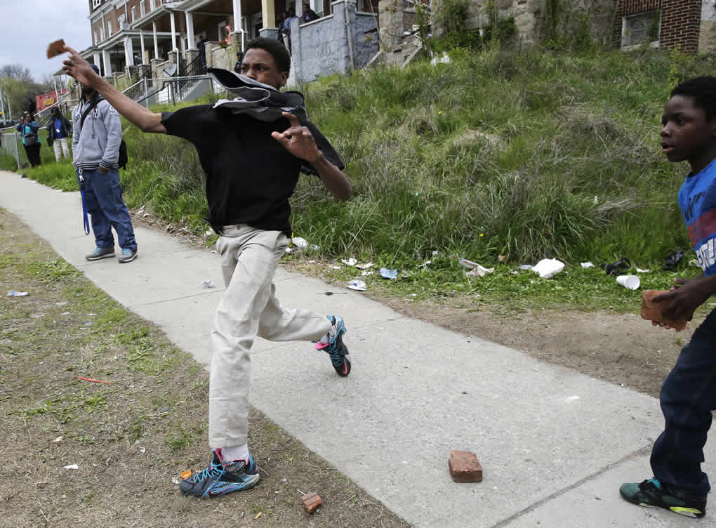 "<div class=""meta image-caption""><div class=""origin-logo origin-image none""><span>none</span></div><span class=""caption-text"">A boy throws a brick at police, Monday, April 27, 2015, during unrest following the funeral of Freddie Gray in Baltimore. (AP Photo/Patrick Semansky)</span></div>"