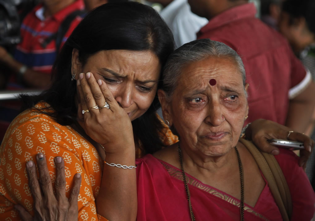 """<div class=""""meta image-caption""""><div class=""""origin-logo origin-image none""""><span>none</span></div><span class=""""caption-text"""">An Indian woman cries as her relative, right who was on pilgrimage in Nepal during Saturday's earthquake, returned at the airport in Ahmadabad, India, Monday, April 27, 2015. (AP Photo/Ajit Solanki)</span></div>"""