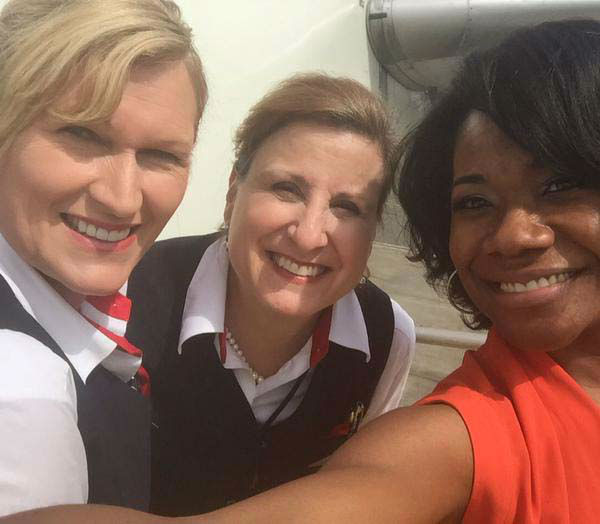 """<div class=""""meta image-caption""""><div class=""""origin-logo origin-image none""""><span>none</span></div><span class=""""caption-text"""">Samica with flight attendants while on vacation (KTRK Photo)</span></div>"""